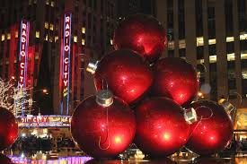 some big tree ornaments by radio city in nyc a