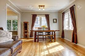 dining room with brown curtain and hardwood floor and leather