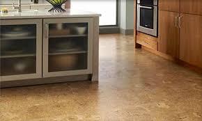 the dark cork floor looks good with the dark countertop cork