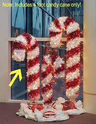 Candy Canes Lights Outdoor by 4 U0027 Pre Lit Tinsel Candy Cane Christmas Yard Art Clear And Red