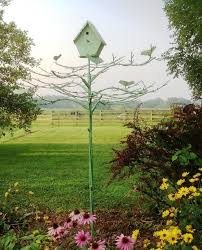 large wrought iron tree birds with a birdhouse