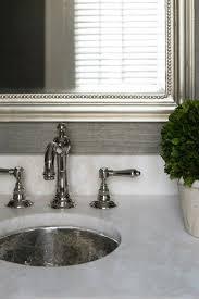 Hammered Silver Bathroom Sink Elegant Bathrom With Gray Grasscloth Silver Leaf Mirror Chrome