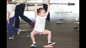 small children lifting weights is a terrible idea but this kid has