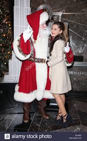 grande and santa claus visit the empire state building in