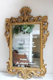 monogram topped wedding timeline sign on ornate gold vintage