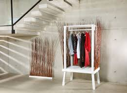 this wardrobe uses willow branches to hide the clothes inside