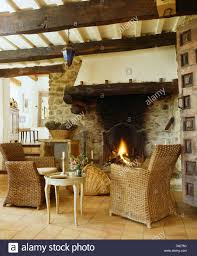 wicker armchairs and small table in french country living room
