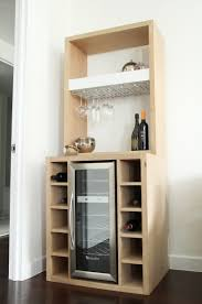 white oak bar with built in wine cooler and glass rack glass
