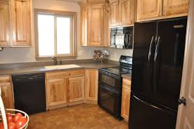 kitchen natural color wooden cabinet and modern black cabinet to