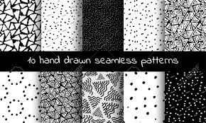 hand drawn seamless triangle pattern with ink doodles black
