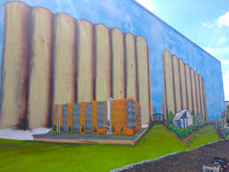a mural comes together in the old first ward buffalo rising buffalo mural ward ny 6