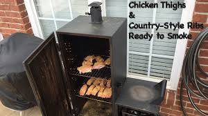 dyna glo vertical smoker chicken thighs u0026 country style ribs in 4k