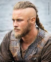 what is going on with travis fimmels hair in vikings ragnar left side tatoo вікінги pinterest ragnar tatoo and