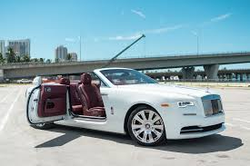 roll royce dawn black rolls royce dawn white miami exotics exotic car rentals