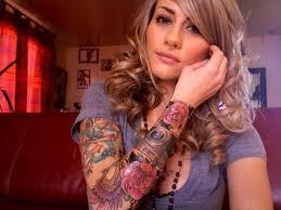 colored ship tattoo on left sleeve