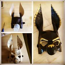 diy anubis mask made from a plastic mask cardboard ears and a