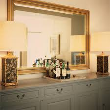 Mirror Over Dining Room Table - black and gold dining room with gold capiz mirrors