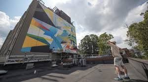 mural brings poet laureate professor s work to life on uva s guinn began painting the mural in june and gradually brought to life a colorful abstract design intended to capture the optimism of dove s poem