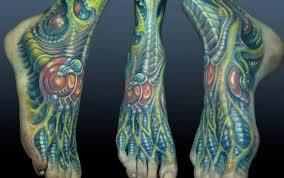 fantastic wrist bio mechanical tattoo design for men