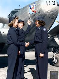 women airforce service pilots wasp gather at the nose of a plane