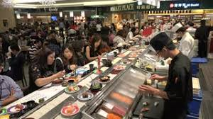 people enjoy lunch in a busy popular food court offering a wide