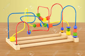 wooden bead toy table wooden bead maze educational toy on the wooden table 3d rendering