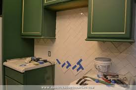 how to install tile backsplash in kitchen how to install a herringbone subway tile backsplash