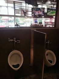 2 way mirror bathroom this sports bar has one way glass in the bathrooms so you don t
