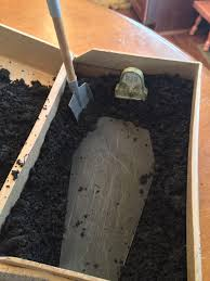 this is a party invitation the coffin was covered in dirt and