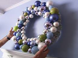 holiday wreath laden with ornaments hgtv