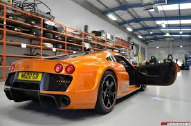 red orange cars factory tour noble gtspirit