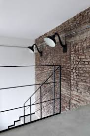 Step Arte Polished Concrete Dark Loft Living Exposed Brick Walls Concrete Floors And Exposed Brick