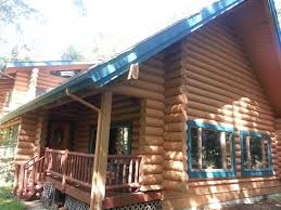 faux painting log cabin exterior ironwood log home restoration