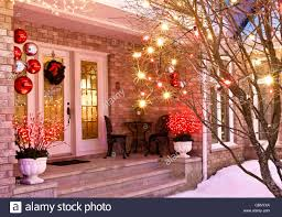 home entrance decorated for christmas including lights wreath