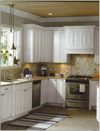 stylish white kitchen cabinet design with silver stove and brown