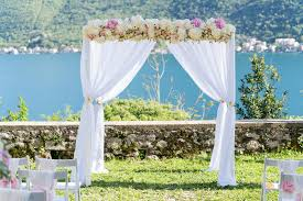 wedding ceremony arch arch for the wedding ceremony decorated with cloth and flowers