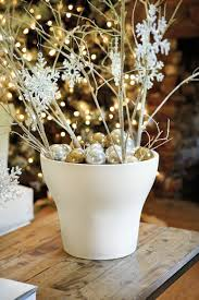 q a with suzanne the holiday collection how to decorate a rafina urn by ballard designs is filled with metallic ornaments and birch branches
