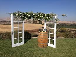 arbor wedding venues diy arbor with doors and olive tree branches created for a