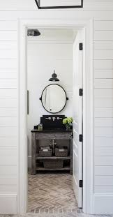 farmhouse powder room they used weathered wood for the console