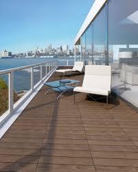 stylish balcony flooring idea for luxury apartment with high glass