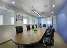 large spaces office meeting room design with dark long oval wood