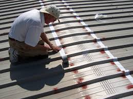 Surecoat Roof Coating by Waterproofing A Flat Metal Roof