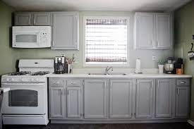Modern Kitchen With White Appliances White And Cherry Wood Kitchen Remodel Contemporary Kitchen Novel