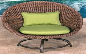 large artificial wicker outdoor chair green cushions wicker