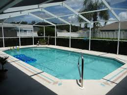 Best Designed Elegant Blue Swimming Pool Design With Glass