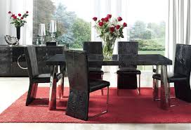 luxury moroccan dining room with dark table high ceiling and three