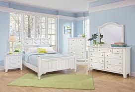 white bedroom with color accents blue purple interior color in
