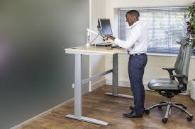 sit stand desk chair new study finds sit stand desks almost double productivity