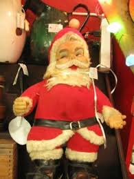 kitschy satin santa ornament from vendor 781 in booth 182 priced