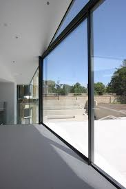 large glass elevation sliding minimal windows bringing the